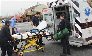 Adult Ed – EPS students loading a stretcher into an ambulance