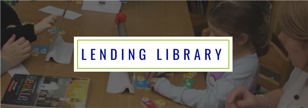 Lending Library Header Image (children smiling while working on laptops)