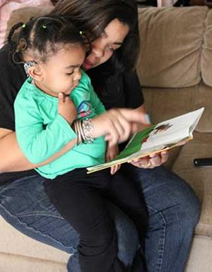 parent reading to hearing impaired child